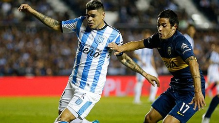 AVELLANEDA, ARGENTINA - OCTOBER 18:  Gustavo Bou of Racing Club fights for the ball with Marcelo Meli of Boca Juniors during a match between Racing Club and Boca Juniors as part of round 28 of Torneo de Primera Division at Presidente Peron Stadium on October 18, 2015 in Avellaneda, Argentina. (Photo by Gabriel Rossi/LatinContent/Getty Images)