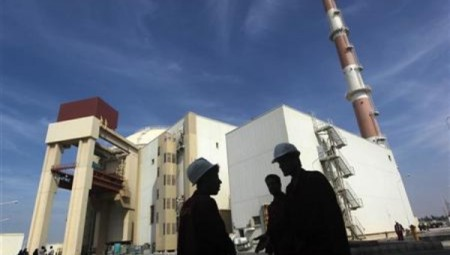 iranian_workers_stand_in_front_of_the_bushehr_nuclear_power_plantx_about_1x200_km_x746_milesx_south_of_tehran.jpg_1718483346